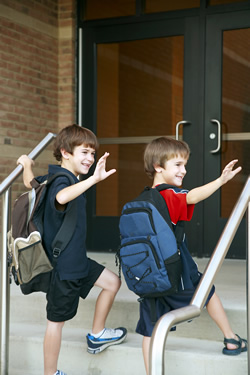 students climbing stairs into school